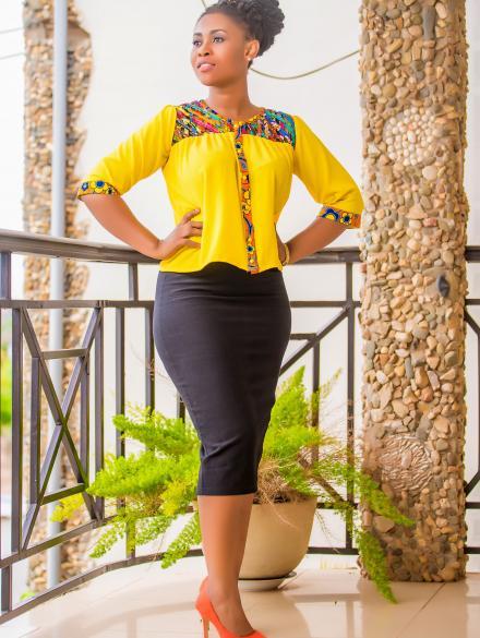 Yellow and woven print top and black skirt
