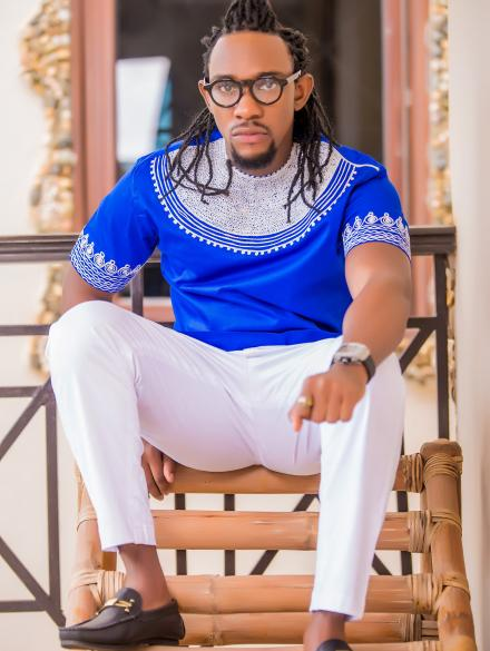 Embroidered blue short sleeve top and White Trouser