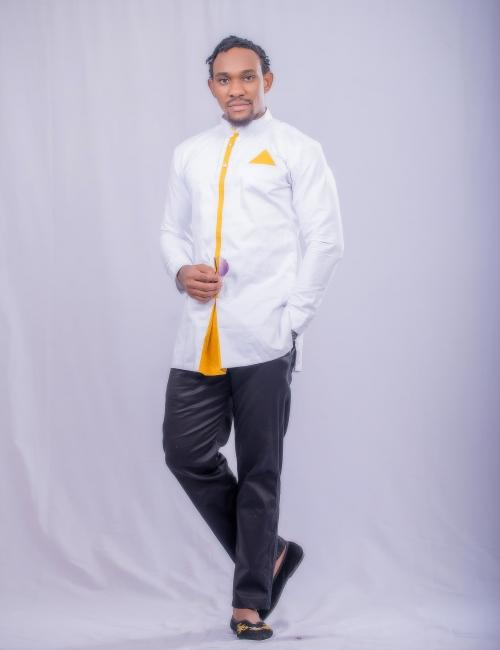 White top and trousers with a gold design in the front